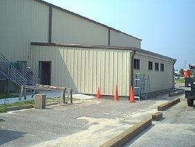 Installation of metal roof and wall panels at Little Creek Amphibious Base, Norfolk, Virginia...