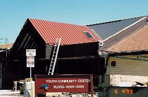 Metal roofing (red); also installed membrane roof system (not visible).