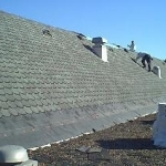 Flat gravel roof was also replaced with white TPO membrane.